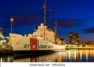 The USGC Taney Coast Guard Cutter at night, in the Inner Harbor of Baltimore, Maryland.