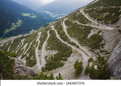 U-shape curved road towards Towers of Fraele, a touristic attraction in North Valtellina, Italy.