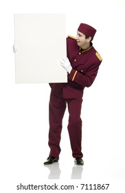 Usher with red uniform holds up a white panel.