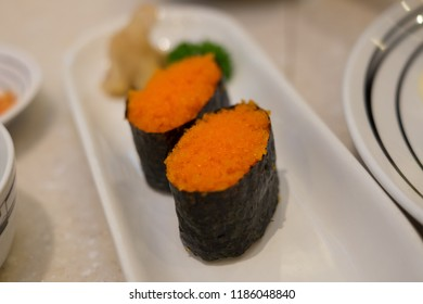 ushi is a Japanese dish of specially prepared vinegared rice, usually with some sugar and salt, combined with a variety of ingredients, such as seafood, vegetables, and occasionally tropical fruits