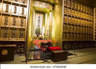 USHIKU, JAPAN - June 29, 2017: Golden standing statues of Buddha inside Ushiku Daibutsu, Ibaraki prefecture, Japan
