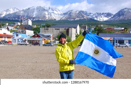 USHUAIA ARGENTINA 11 27 11: Man waving Argentina flag in Ushuaia is the capital of Tierra del Fuego, Argentina. It is commonly regarded as the southernmost city in the world