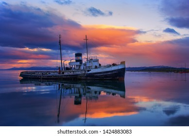 USHUAIA, ARGENTINA – APRIL 08, 2019: The Saint Christopher is an abandoned tugboat that lies grounded in the bay of Ushuaia. It is now one of the landmarks of this city