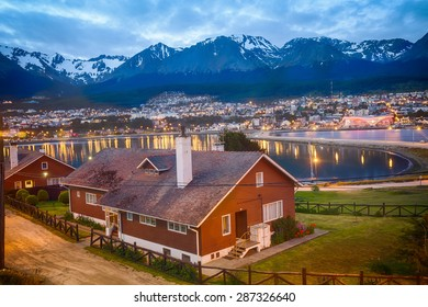 USHUAIA, ARGENTINA - December 28, 2014: Residential area of Ushuaia with the Andes, the longest continental mountain range in the world in the background