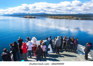 USHUAIA, ARGENTINA - December 28,2014: Tourists visiting a site overlooking the Les Eclaireurs Lighthouse also known as the End of the World Lighthouse located on the Beagle Channel.
