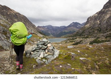 USHUAIA, ARGENTINA - FEBRUARY 08 2018: an unidentified backpacker in a trail of Valdivieso mountain range, Ushuaia, Tierra del Fuego island, Patagonia Argentina, South America