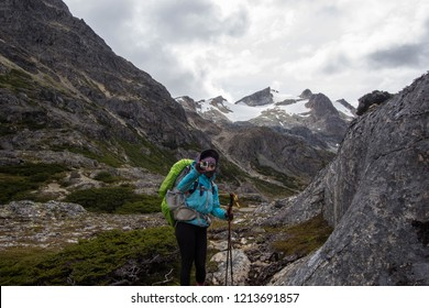USHUAIA, ARGENTINA - FEBRUARY 08 2018: an unidentified backpacker in a trail of Valdivieso mountain range, Ushuaia in Tierra del Fuego island, Patagonia Argentina, South America