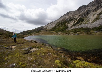 USHUAIA, ARGENTINA - FEBRUARY 08 2018: an unidentified backpacker walking in a trail of Valdivieso mountain range, Ushuaia in Tierra del Fuego island, Patagonia Argentina, South America