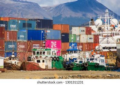 USHUAIA, ARGENTINA - February 2018: Cargo port in Ushuaia, containers and cargo ships at Ushuaia harbor, Tierra del Fuego, Argentina