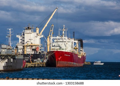 USHUAIA, ARGENTINA - February 2018: Cargo ships in the port in Ushuaia, containers and cargo ships at Ushuaia harbor, Tierra del Fuego, Argentina