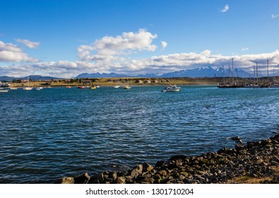 USHUAIA, ARGENTINA - February 2019: Aerial view of Ushuaia bay with boats on sunny day in Ushuaia town, Tierra del Fuego, Argentina