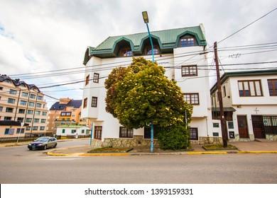Ushuaia, Argentina - February 2019: Ushuaia cityscape, houses along the road on rainy cold day, Fin del Mundo, Tierra del Fuego, Argentina