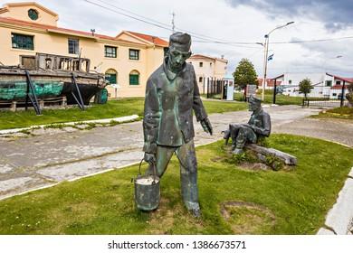 USHUAIA, ARGENTINA - February 2019: Ushuaia Jail Museum (Museo Marítimo y del Presidio de Ushuaia), entrance with prisoner bronze statues, Tierra del Fuego, Argentina
