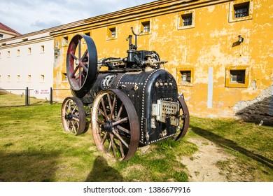USHUAIA, ARGENTINA - February 2019: Ushuaia Jail Museum (Museo Marítimo y del Presidio de Ushuaia), diesel locomotive at the entrance of Jail Museum, Tierra del Fuego, Argentina