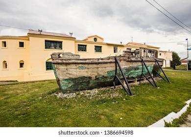 USHUAIA, ARGENTINA - February 2019: Ushuaia Jail Museum (Museo Marítimo y del Presidio de Ushuaia), old wooden vessel in the museum yard, Tierra del Fuego, Argentina