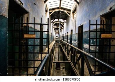 USHUAIA, ARGENTINA - February 2019: Ushuaia Jail Museum (Museo Marítimo y del Presidio de Ushuaia) gloomy corridor, former prison interior in Ushuaia, Tierra del Fuego, Argentina
