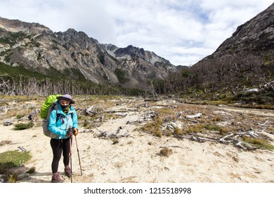 USHUAIA, ARGENTINA - FEBRUARY 6 2018: an unidentified backpacker walking in a trail of Valdivieso mountain range, Ushuaia in Tierra del Fuego island, Patagonia Argentina, South America
