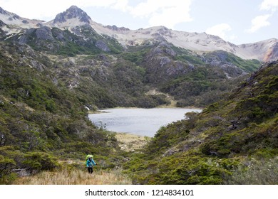 USHUAIA, ARGENTINA - FEBRUARY 7 2018: an unidentified backpacker in a trail of Valdivieso mountain range, Ushuaia, Tierra del Fuego island, Patagonia Argentina, South America