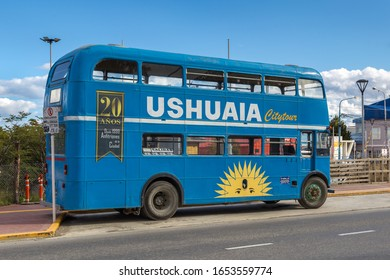 USHUAIA, ARGENTINA - JANUARY 4, 2020: Old blue tourist bus on street in Ushuaia, Tierra del Fuego province, Argentina