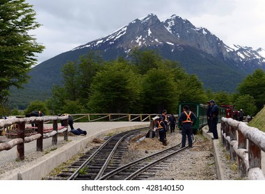 USHUAIA, ARGENTINA - NOVEMBER 17,2014: Rail workers on the southern Pacific railroad. The southernmost railway in the world on the edge of the Earth. Ushuaia National Park Tierra del Fuego.