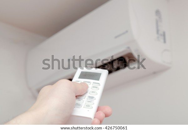 Using air conditioner, remote close up