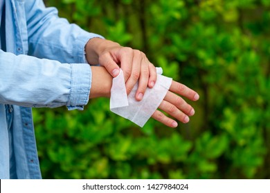 Using antibacterial wet wipes for disinfection hands in park