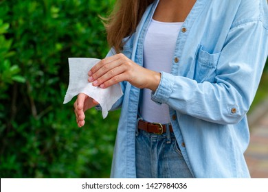 Using antibacterial wet wipes for disinfection hands outdoors