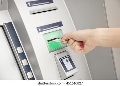 Using ATM machine.