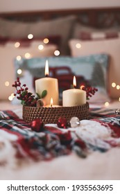 Using Candles in home décor as part of the centerpiece or styled on trays. Both lit and unlit candles. Bokeh lighting. candle flames. Christmas decor using candles