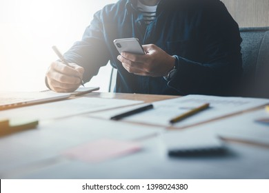 using cell phone contact business people working writing information documents in typical offices. Internships or partner friends.student prepare exams education scholarship to study abroad