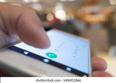 using cellphone to dial, closeup image focus on the button