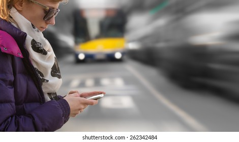 Using cellphone outdoors while crossing the street. Danger!