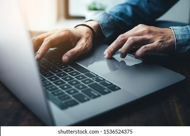using computer.hand typing message on keyboard laptop chatting friend search information form internet while working on computer concept for technology device contact communication business people