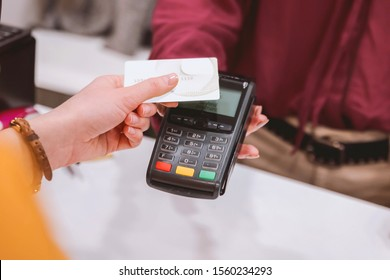 Using credit card to make a payment.
