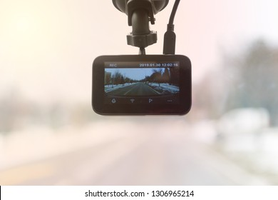 Using dashboard camera to continuously record a view through a vehicle's front windscreen