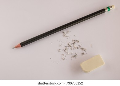 Using an eraser and pencil on a white background.Concept of delete removing.