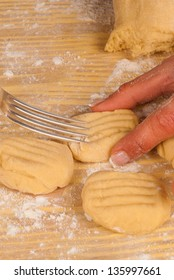 Using a fork to mark a pattern on  raw cookie dough