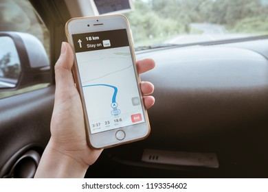 Using GPS navigation application on smartphone to get direction to destination, Map application, Navigator