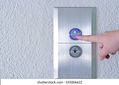 Using hands, press the elevator up and keypad elevator