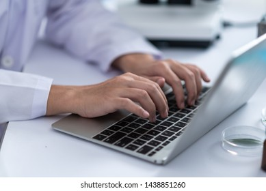 using laptop for working in laboratory