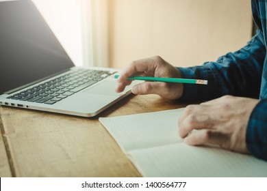 using laptop,computer.contact business people working writing information documents in typical offices. Internships or partner friends.student prepare exams education scholarship to study abroad