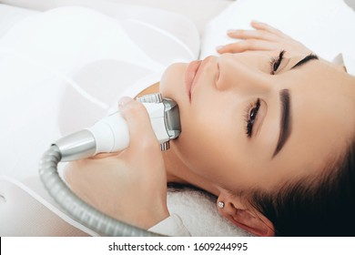 Using the LPG apparatus, the beautician performs a face lift massage. Face contour lift, close-up