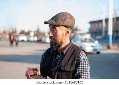 Using mobile phone Asian lod man.