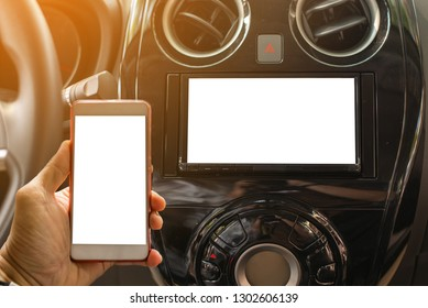 Using Mobile Phone Device While Driving. Hands Free Talking and Listening Online Music While Traveling by Car.Pairing Smartphone with Car Multimedia Audio System.