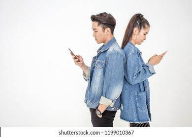 Using mobile smartphone outdoor - Happy friends having fun with technology trends - Youth, new generation addiction and friendship concept