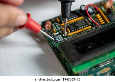 Using a multimeter to measure resistance on the resistor.