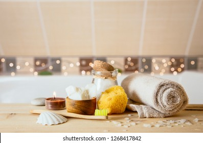 Using natural material products in home, different eco friendly cosmetic products in bathroom. Minimizing ecological footprint concept. Bamboo bath towel, biodegradable bamboo toothbrush, coconut oil.