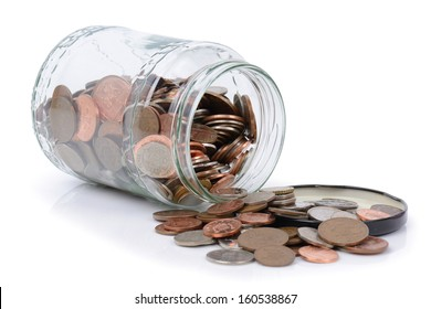 using the rainy day fund, coins spilling out of a jar
