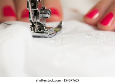 using a sewing machine and showing the sewing process
