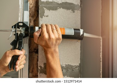 Using silicone adhesive with a glue gun to repair windows.